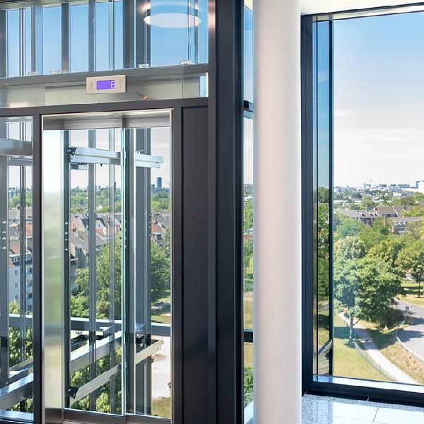 Arcadia Parc interior view through glass elevator 09th floor
