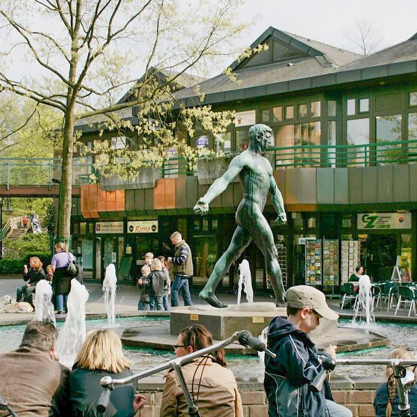 Klemensviertel view of sculpture titeled 'Der Sähmann' at lively fountain square