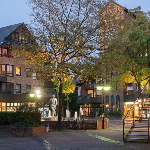 Klemensviertel fountain square with skulpture in evening mood