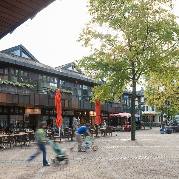 Klemensviertel busy fountain square with surrounding stores