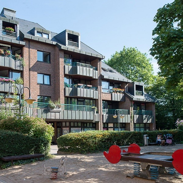 Klemensviertel facade of residential and commercial buildings with playground in front