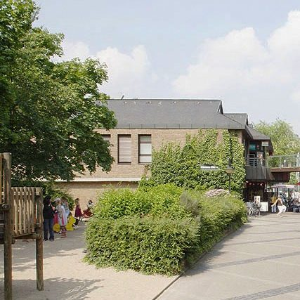 Klemensviertel facade of commercial buildings with playground in front