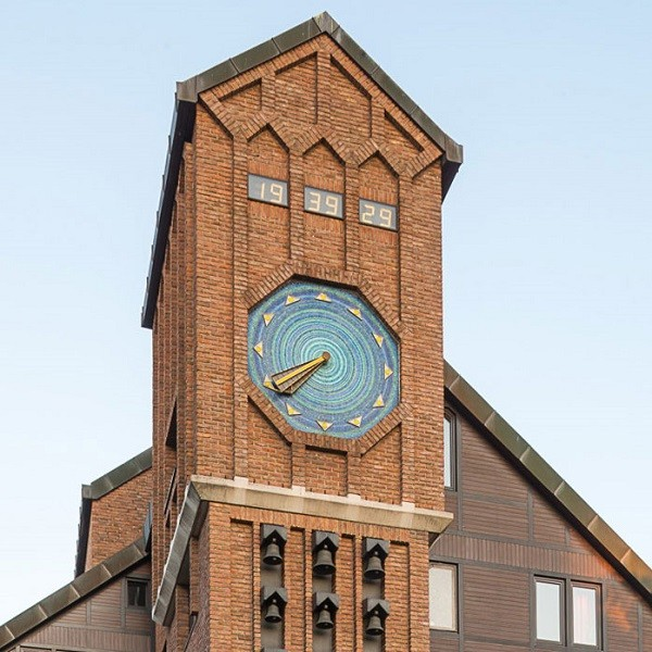 Klemensviertel detail bell tower made from brick stone with clock
