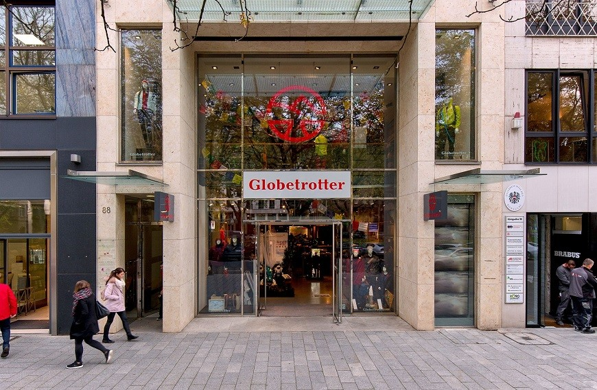 Königsallee 88 detail of glass front store Globetrotter with pedestrians walking along