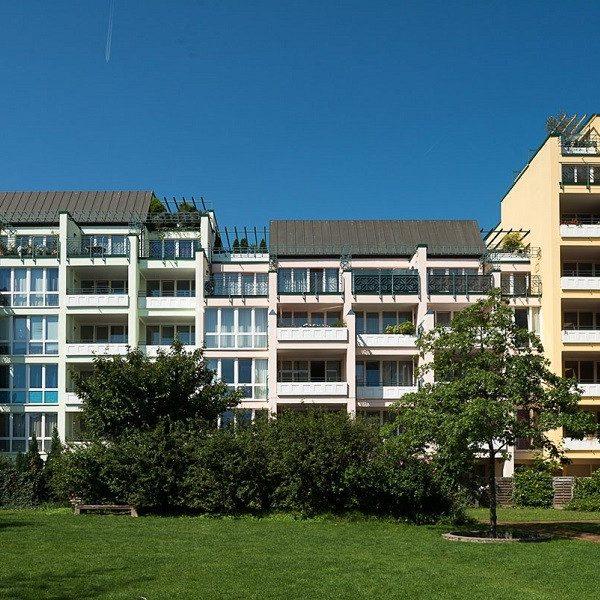 Prinzenpark facades of residential buildings in pastel colors seen from park