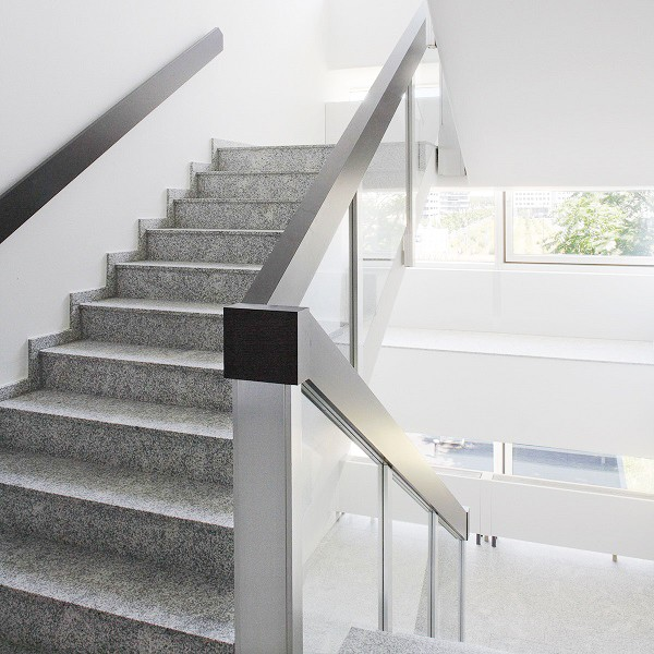 Take-Off interior view staircase granite and stainless steel