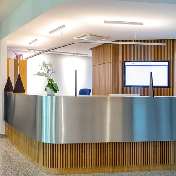 Arcadia Stern interior view reception counter in wood and stainless steel with information monitor