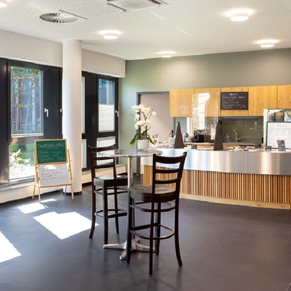 Arcadia Stern interior view modern canteen with view to green courtyard