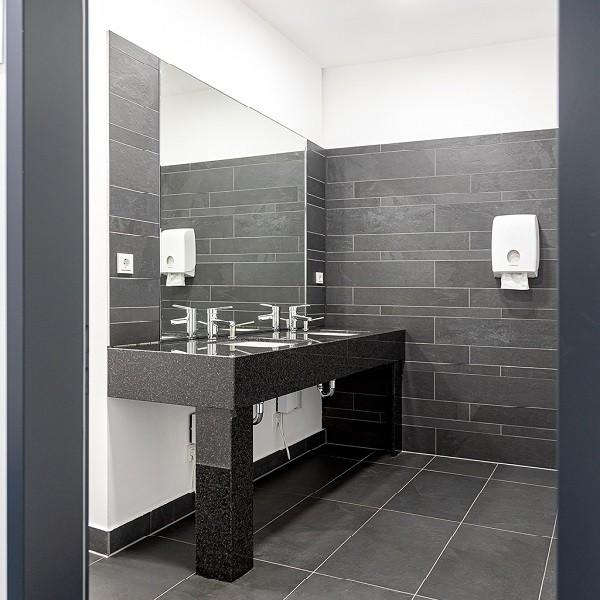 Arcadia Stern interior view modern restroom tiled in slate look