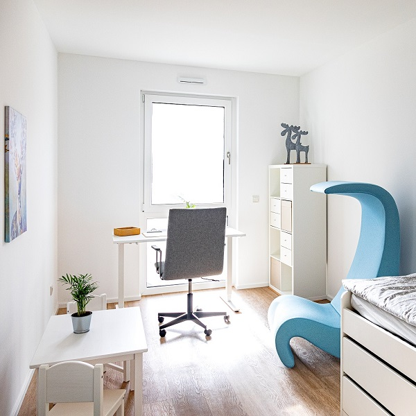 Arcadia Höfe Arcadia Höfe sample apartment children's room furnished in white with blue and grey color accents